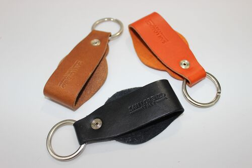 Genuine Leather Round Key Chain shown in Orange, Cognac, and Black