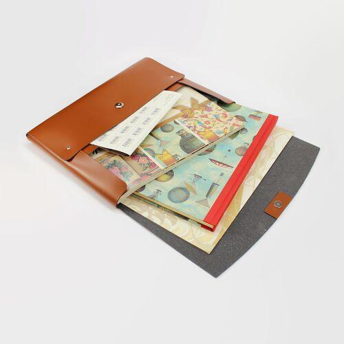 The Napoli Portfolio with Handle holds slim books inside